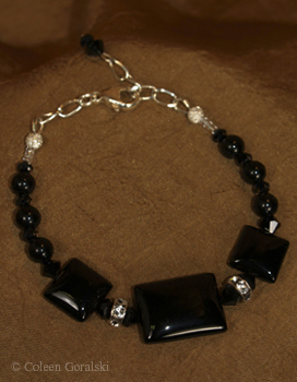 Black Onyx Swarsovski and Sterling Bracelet -adjustable in length 7-8 inches